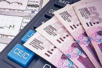 Расчет и удержание налога за акции по итогам года